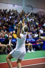 Martina Navratilova excutes a strong first serve during the WTT Smash Hits at American University's Bender Arena.
