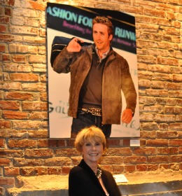 Jan Cousteau posing with the photograph of her son, Philippe Cousteau from the 2010 Runway Show. Photo Courtesy of REVAMP.com.