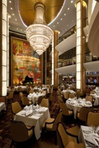 An ornate chandelier hangs in the main dining room of the Adagio. Image by Royal Caribbean.