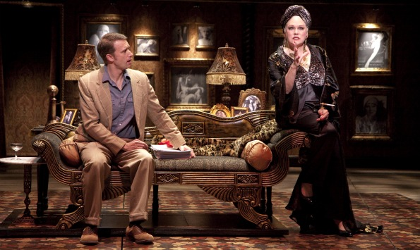 Florence Lacey (as Norma Desmond) discusses her opus screenplay of Salomé with D.B. Bonds (Joe Gillis) in Sunset Boulevard. At Virginia's Signature Theatre through February 13, 2011. Photo by Scott Suchman.