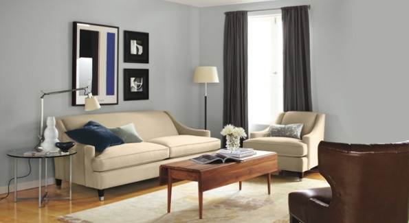 Room and Board's Loring Sofa serves as a neutral base for bright purple accents.