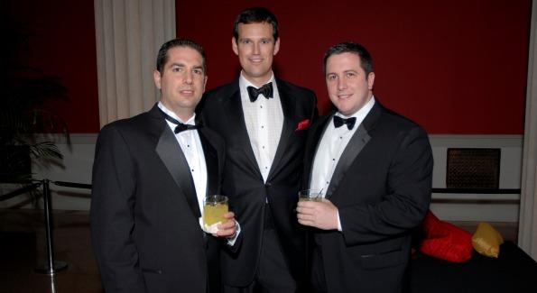 Luke's Wings host committee member Fletcher Gill (center). Photo by Kyle Samperton.