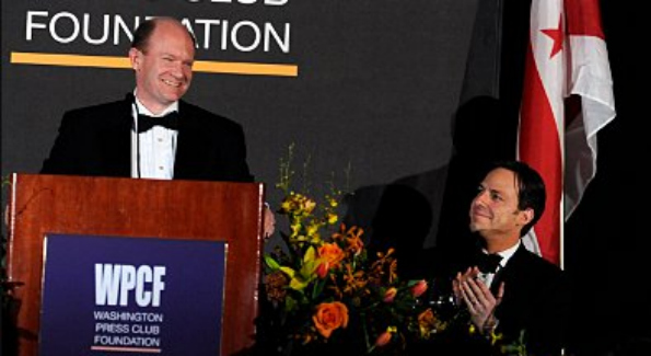 Sen. Chris Coons (D-Del.) gets laughs from the audience at the Washington Press Club Foundation dinner. (Tom Williams)