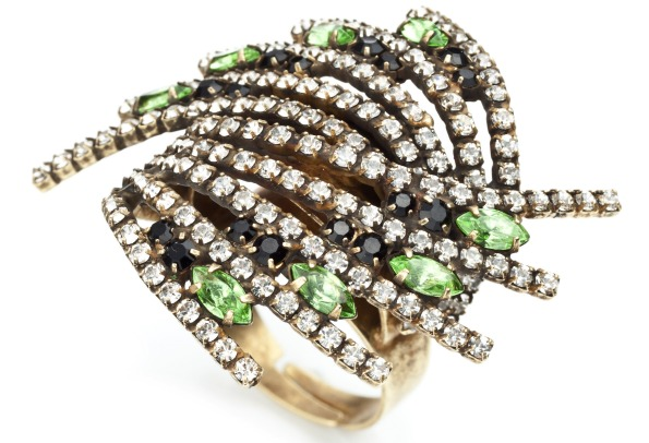 """Vaughn"" cocktail ring with diamonds, emeralds, and Swarovski crystal elements on an oxidized brass-plated ring. ($245); Dannijo, www.dannijo.com."
