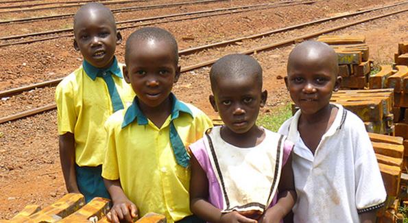 Children at the Jinja railway station in Uganda, photo by John Hanson