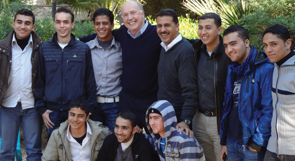 With CMBM Gaza program director Jamil Abdel Atti and youth group, Gaza City, 2010. (Photo courtesy Dr. James S. Gordon)