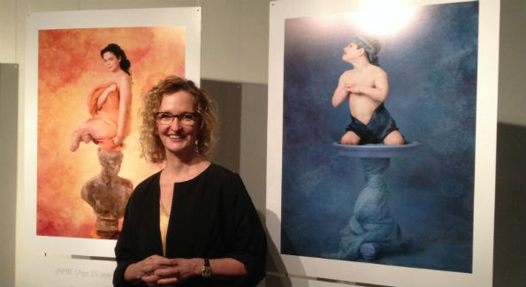 """Anne Geddes with portraits from """"Protecting Our Tomorrows: Portraits of Meningococcal Disease."""" (Photo by Erica Moody)"""
