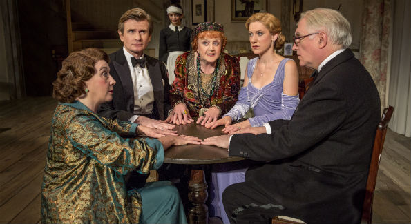 "Sandra Shipley as Mrs. Bradman, Charles Edwards as Charles Condomine, Susan Louise O'Connor as Edith, Angela Lansbury as Madame Arcati, Charlotte Parry as Ruth Condomine and Simon Jones as Dr. Bradman in Noël Coward's ""Blithe Spirit."" (Photo by Joan Marcus)"
