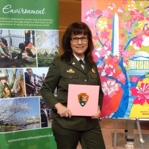 Karen Cucurullo with the envelope holding peak bloom predictions (Photo by Erica Moody)