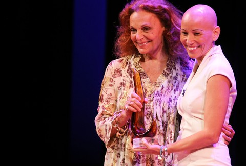 Diane von Furstenberg, left,  presents Karla Ruiz Cofino of Guatemala with her award during the  14th Annual Global Leadership Awards Tuesday, June 16, 2015 in Washington at the Kennedy Center. (Sharon Farmer/sfphotoworks)