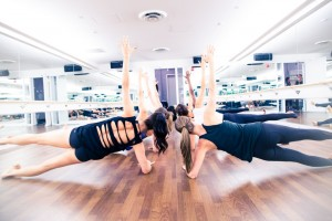 FlyBarre classes use a series of small, intense interval exercises choreographed to contemporary and inspiring music to reshape the body for strong, lean and elongated muscles. (Photo courtesy Flywheel)