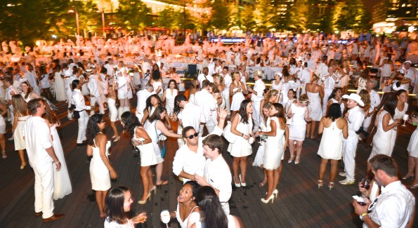 The global phenomenon secret dinner party, Diner en Blanc, attracted over 1,300 guests all wearing white.  (Photo by Ben Droz)