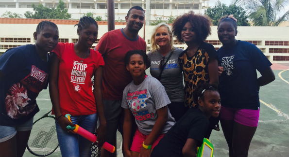 Deborah SIgmund with Ninos De Cristo girls and basketball coach (Photo courtesy of Deborah Sigmund)