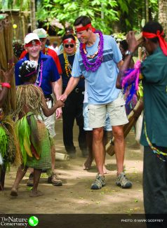 Mark Tercek greeted by native participants in singsing welcoming ceremony at Tarobi village on the Kimbe Bay Coast in West New Britain, Papua New Guinea (Photo by Mark Godfrey © 2008 The Nature Conservancy)