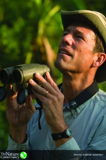 Mark Tercek during a birding tour of the rainforest above Kimbe Bay in Papua New Guinea (Photo by Mark Godfrey © 2008 The Nature Conservancy)
