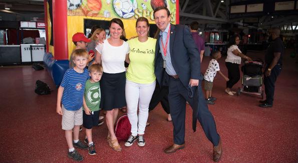 Sen. Chris Murphy and family with Ellen Palmer, director, Home Runs for Horton's Kids. Photo by Jenn Reid & Jim Kurtz.