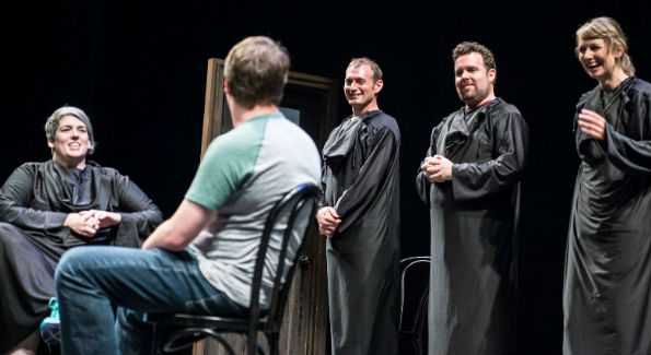 UCB actors, disguised as grim reapers, Shannon O'Neil, Brandon Scott Jones, Connor Ratliff and Molly Thomas interview a member of the audience