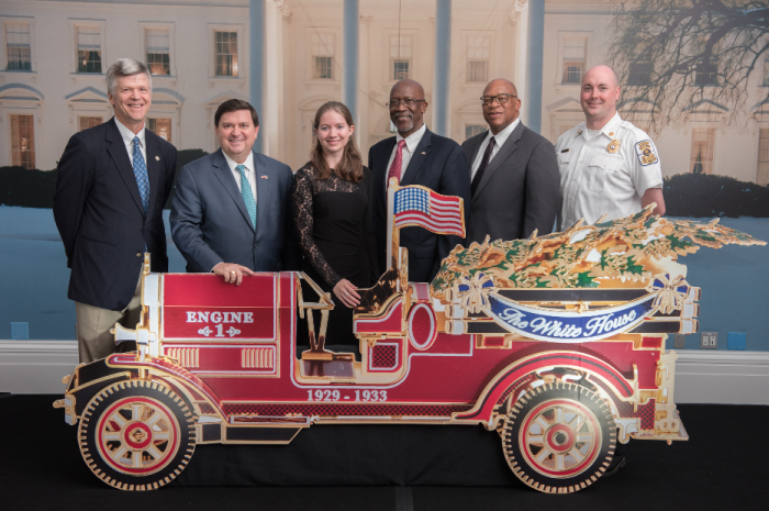 Bill Webb, Stewart McLaurin, Kayla Whelan, Chief Ernest Mitchell, Jr., Chief Gregory Dean, and Chief John Morrison with a model of the 2016 Ornament. (Photo by Matthew DAgostino)