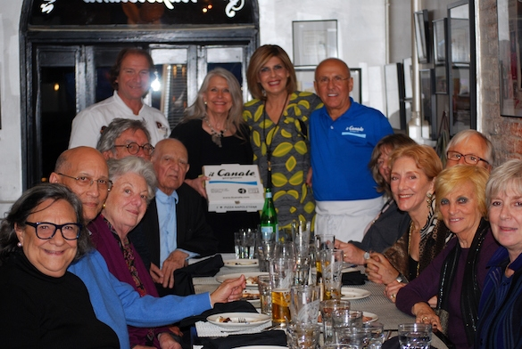 Gennaro Luciano (far left), Joe Farruggio (far right), his wife Teresa, and family members celebrate the partnership of Il Canale and Antica Pizzeria Port' Alba.