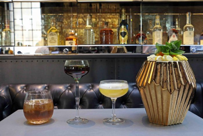 Dirty Habit's cocktails, including the large-format (far right) to be shared among friends.